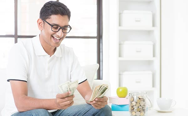 smiling-man-with-cash-in-hand