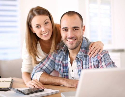 young-couple-with-computer-and-calculator