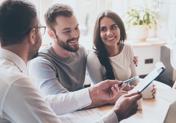 happy-couple-discussing-seller-paid-closing-costs-with-loan-officer