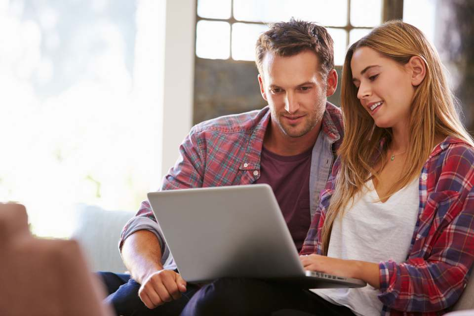 couple-looking-at-laptop