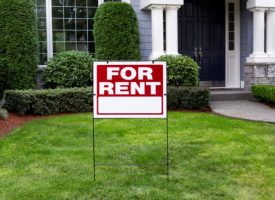 for-rent-sign-in-front-yard