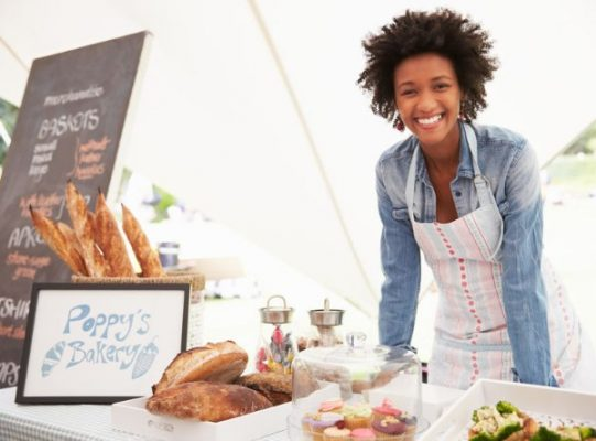smiling-small-business-owner-selling-baked-goods